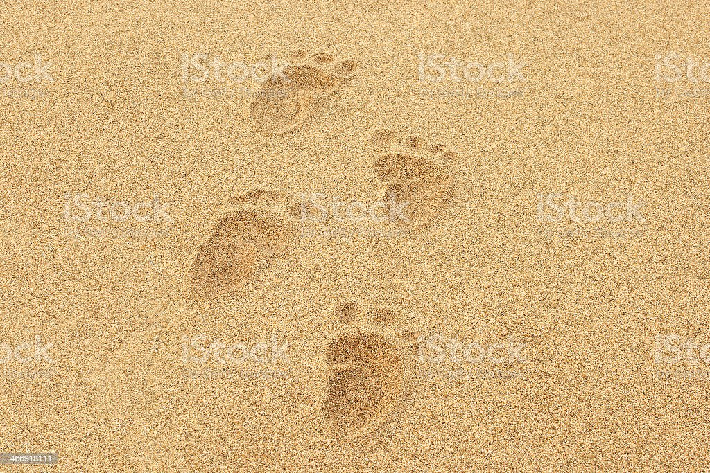 Baby Footprints in the sand of a beach stock photo