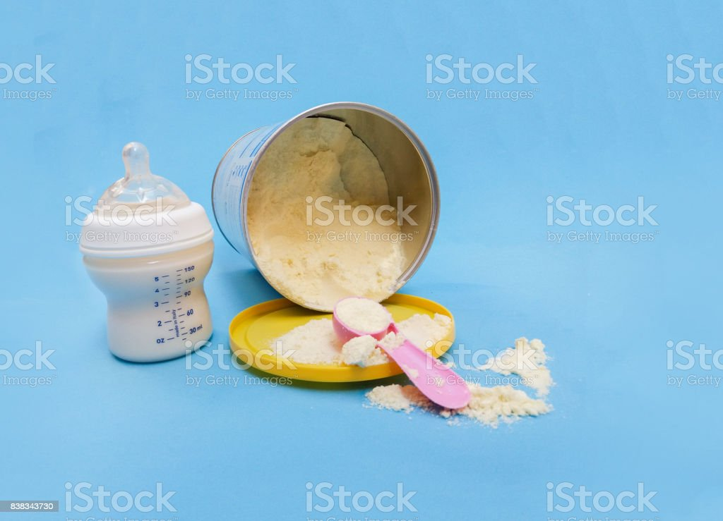 baby formula and bottle with milk stock photo