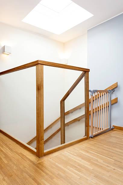 Baby gate on a staircase stock photo