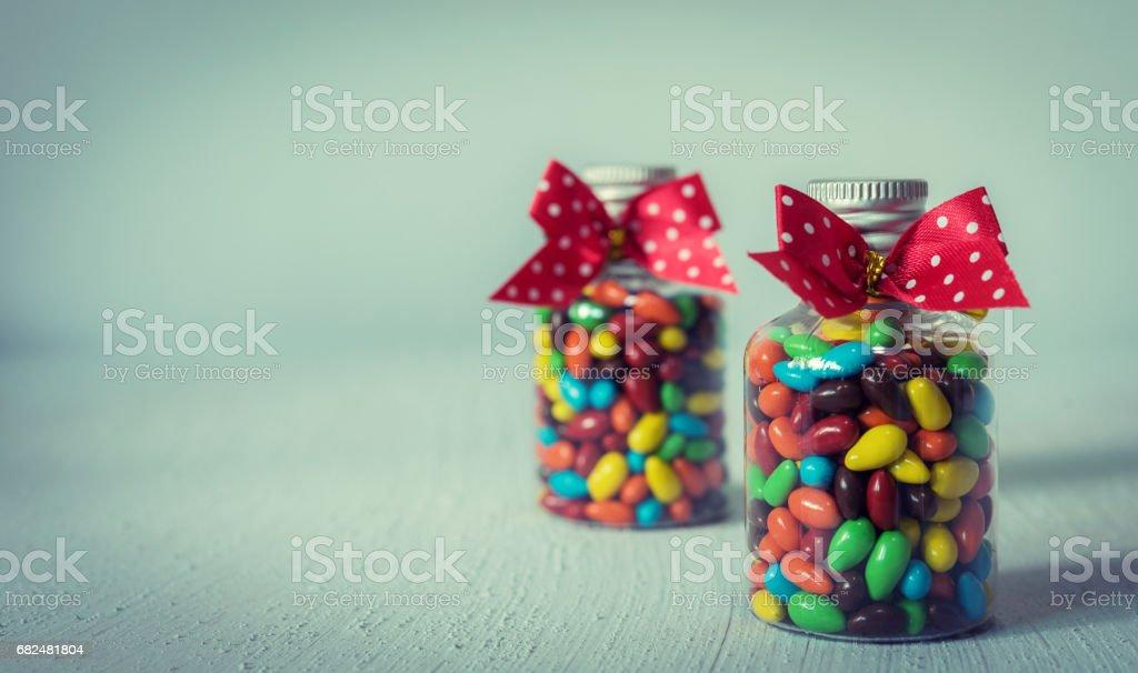Baby Gift Colorful candies in jar on table foto de stock libre de derechos