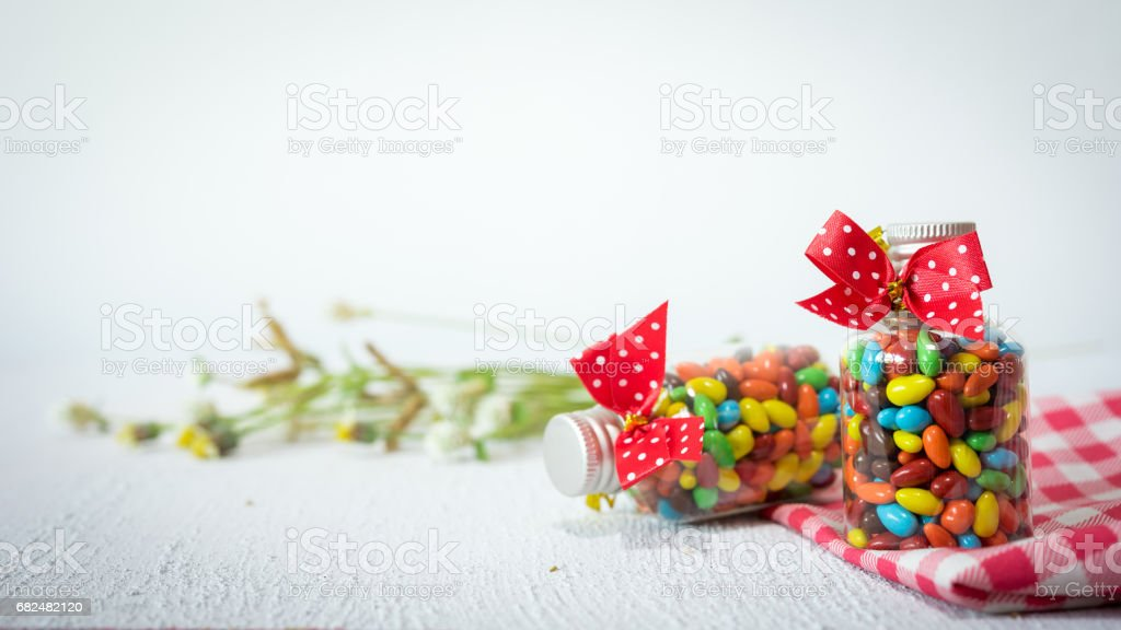 Baby Gift Colorful candies in jar on table Lizenzfreies stock-foto