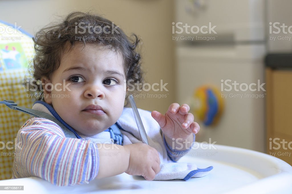 Baby Girl 17 Months Old Sitting In High Chair royalty-free stock photo