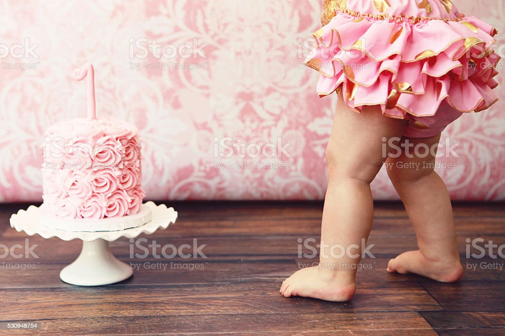 Baby Girl and Birthday Cake stock photo