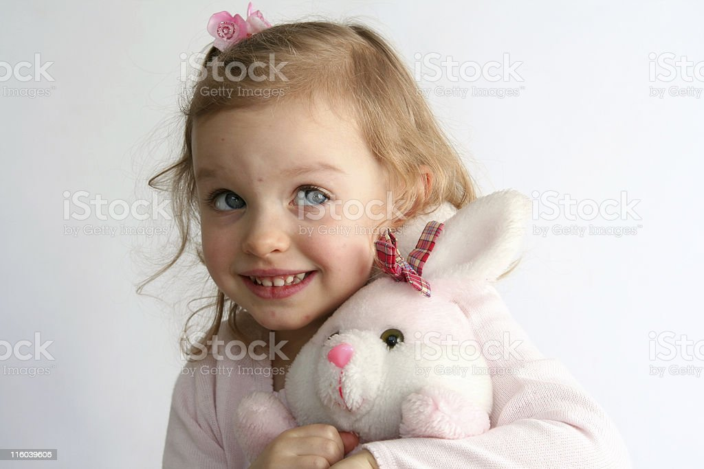 Baby girl and pink bunny stock photo