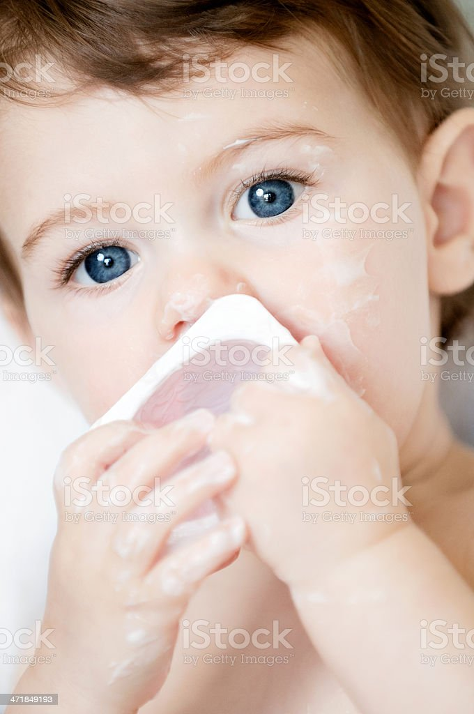 Baby Girl And Yogurt royalty-free stock photo
