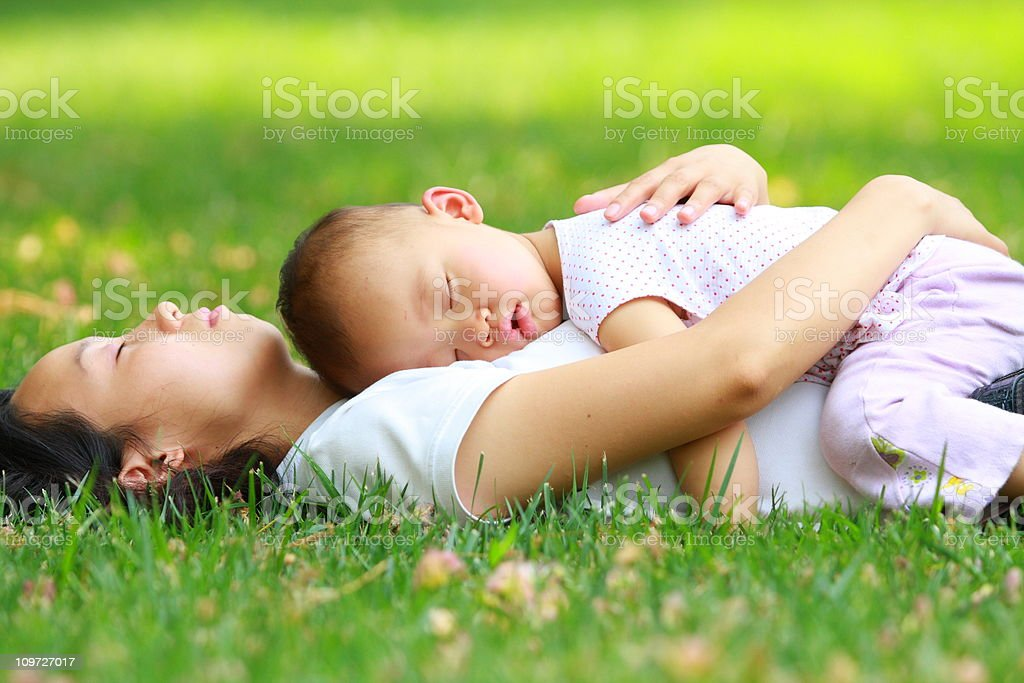 baby girl asleep on her mom's chest royalty-free stock photo