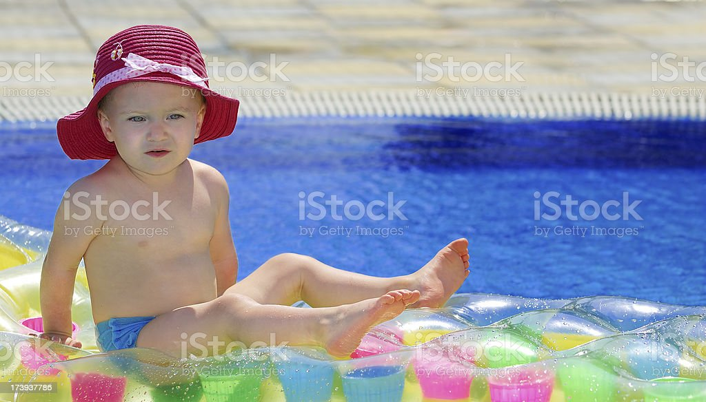 Baby girl at pool royalty-free stock photo