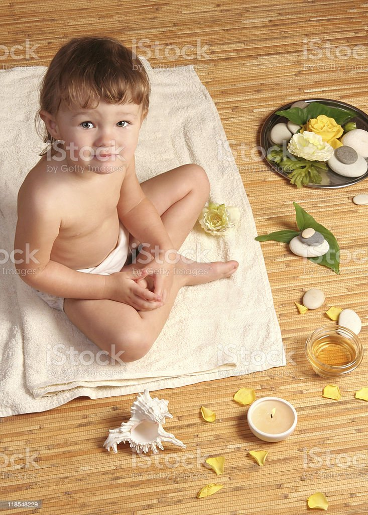 baby girl at spa treatment stock photo