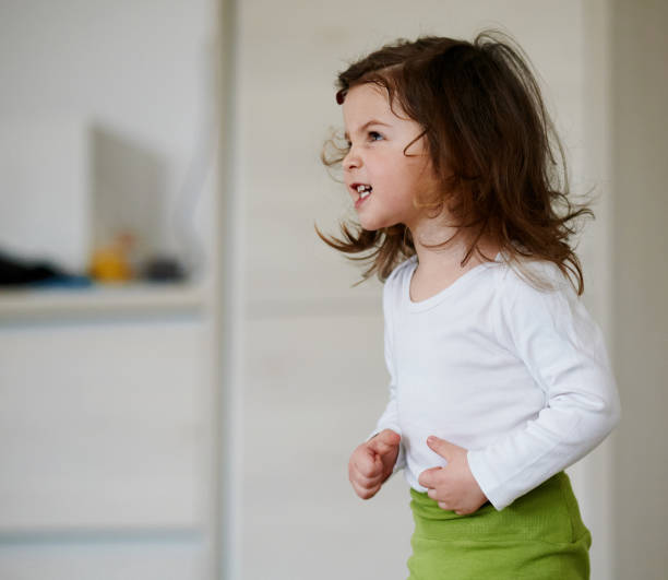 Baby girl being angry stock photo