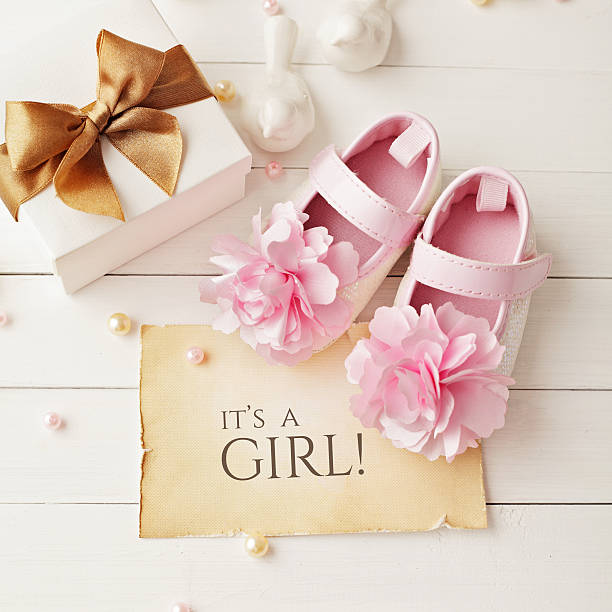 baby girl birthday greeting card - its a girl stock photos and pictures