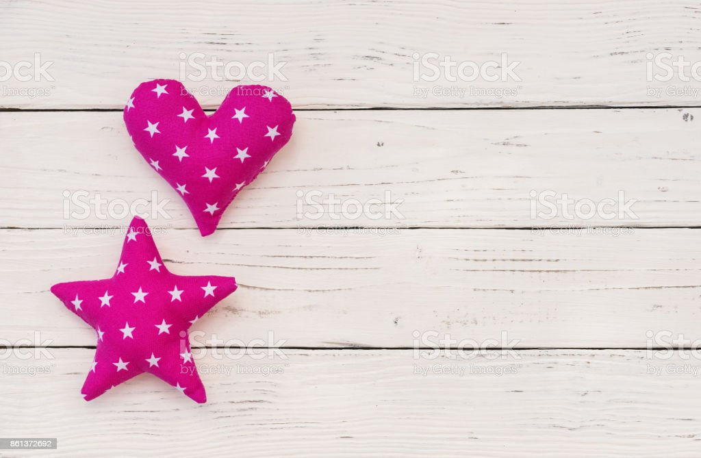 Baby girl birthday greeting card with pink heart and star shape stock photo