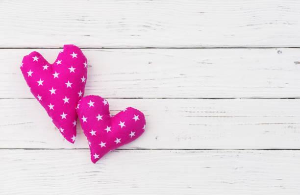 baby mädchen geburtstag grußkarte mit rosa herzen - sterntaufe stock-fotos und bilder