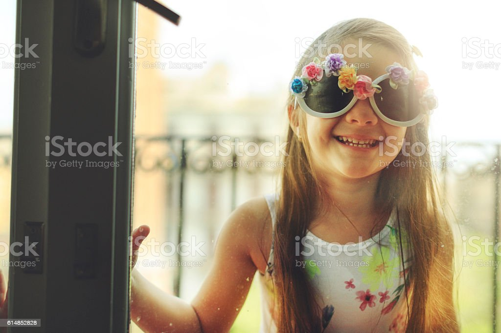 Baby girl by a window stock photo