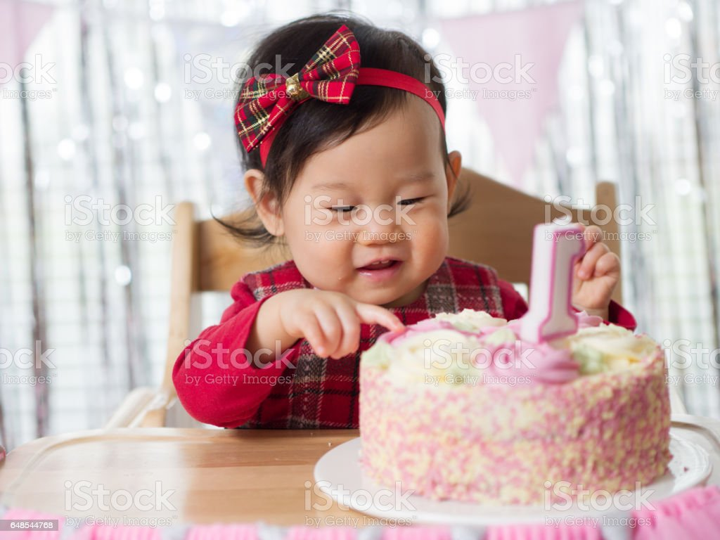 baby girl celebrate her first birthday stock photo