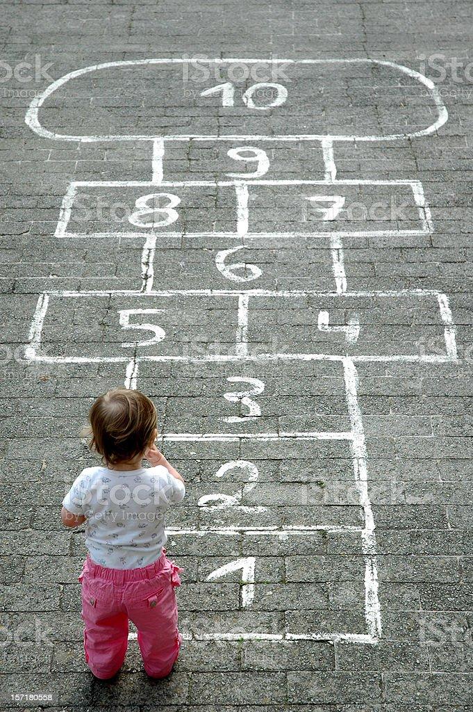 Baby Girl Childsplay Hopscotch royalty-free stock photo
