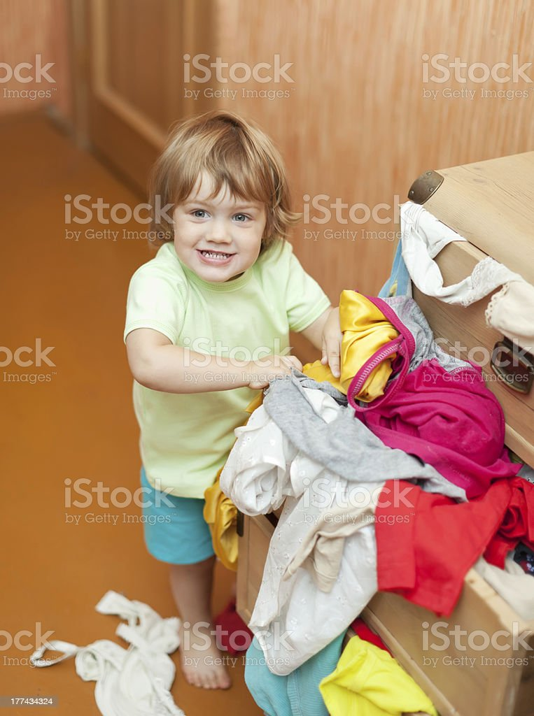 Baby girl  chooses dress stock photo