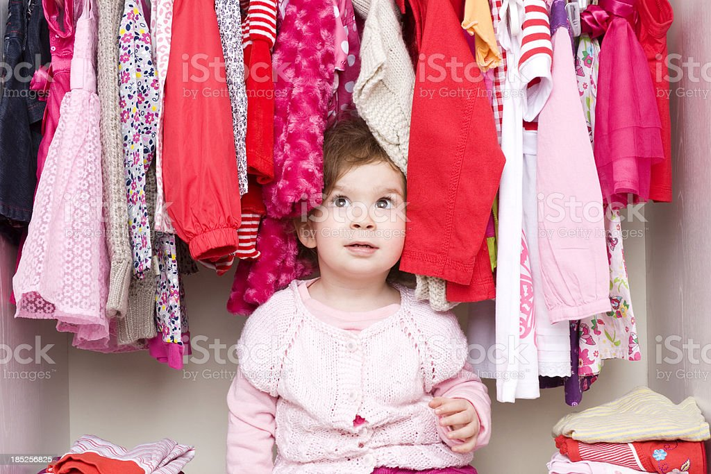 Baby girl choosing her clothes royalty-free stock photo