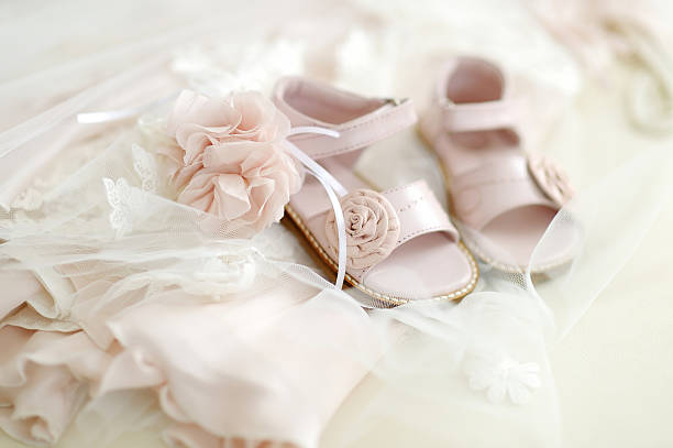 Baby girl christening shoes stock photo