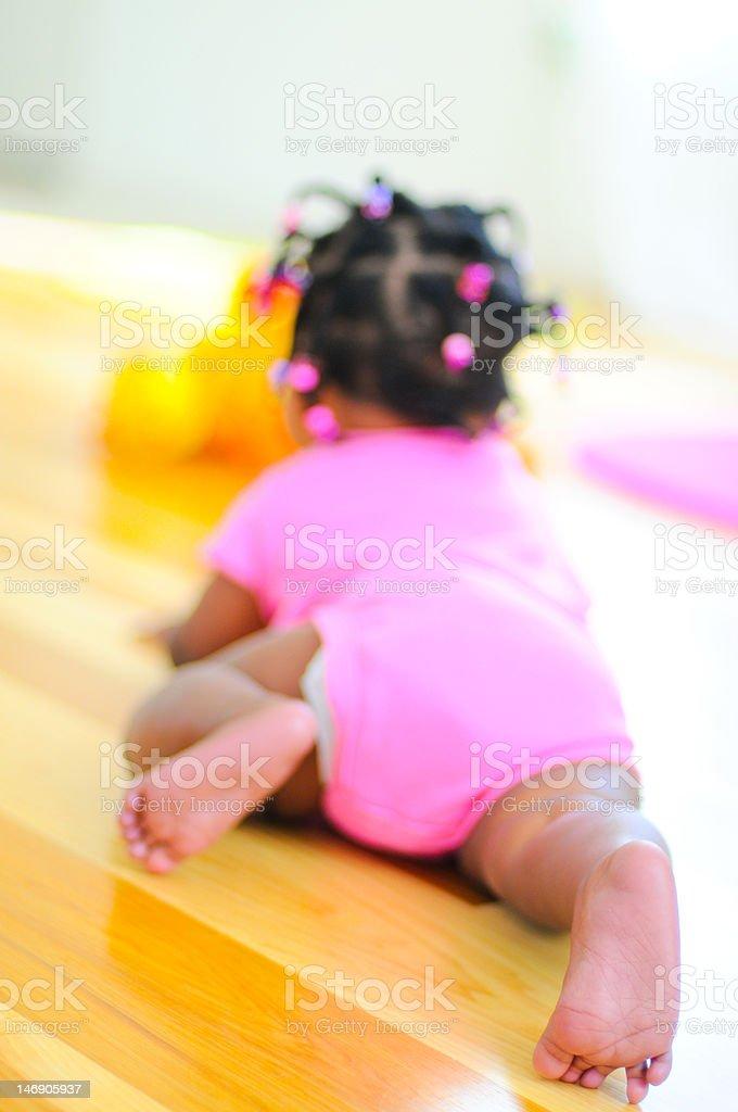 Baby girl crawling away stok fotoğrafı