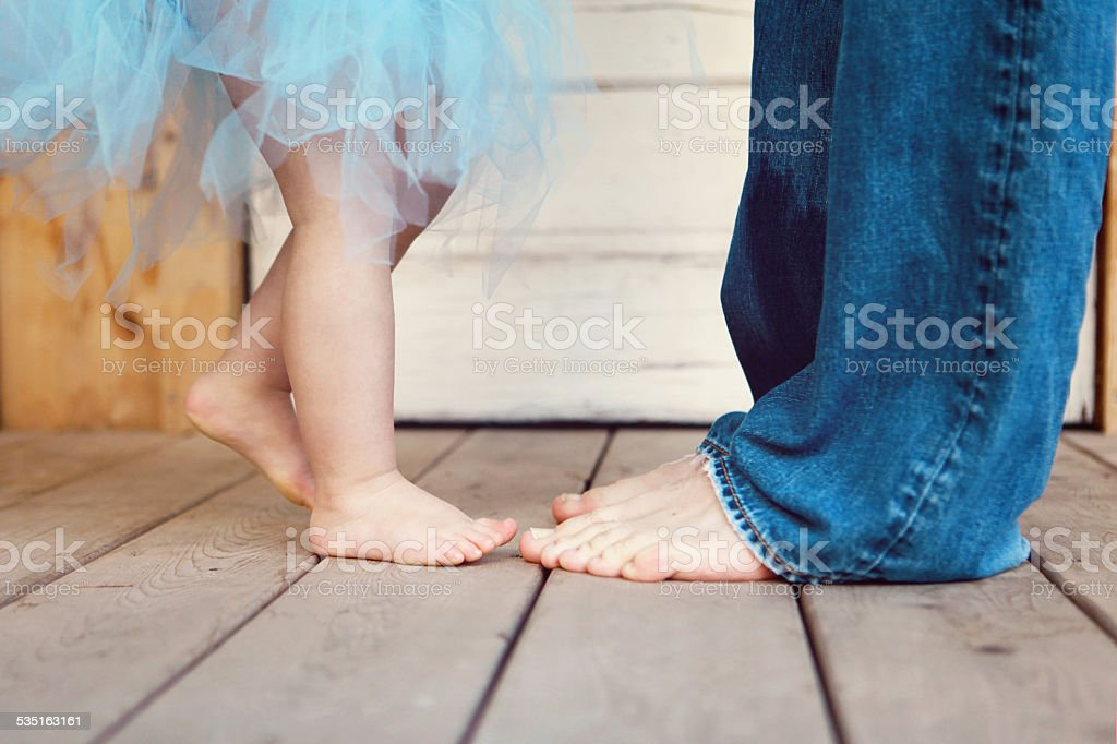 Baby Girl Dancing With Her Daddy stock photo