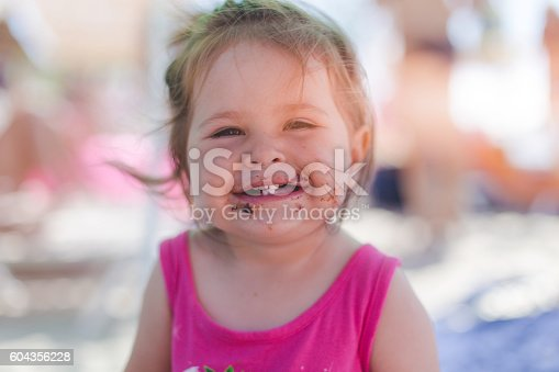 604367022 istock photo Baby girl dirty from eating chocolate cake 604356228