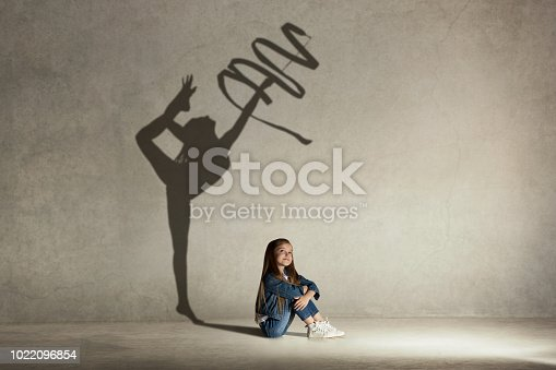 istock Baby girl dreaming about gymnast profession. Childhood concept 1022096854