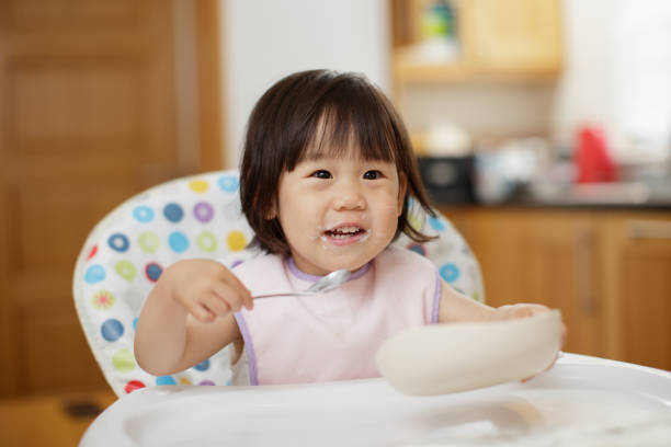 197 Asian Kid Eating Yoghurt Stock Photos, Pictures & Royalty-Free Images -  iStock