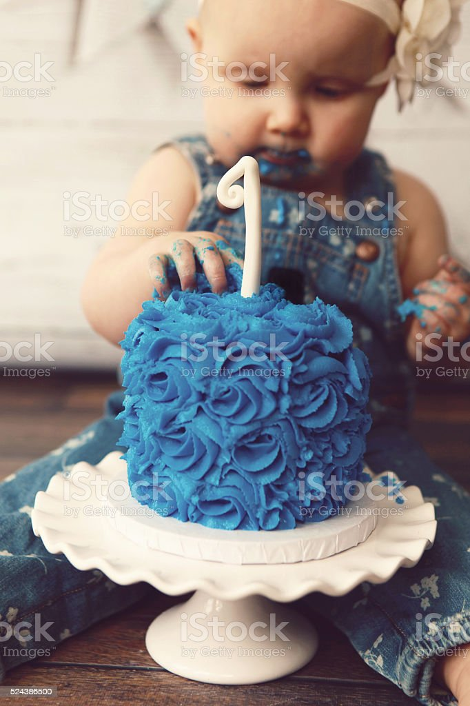 Cool Baby Girl Eating Her First Birthday Cake Stock Photo Download Personalised Birthday Cards Paralily Jamesorg