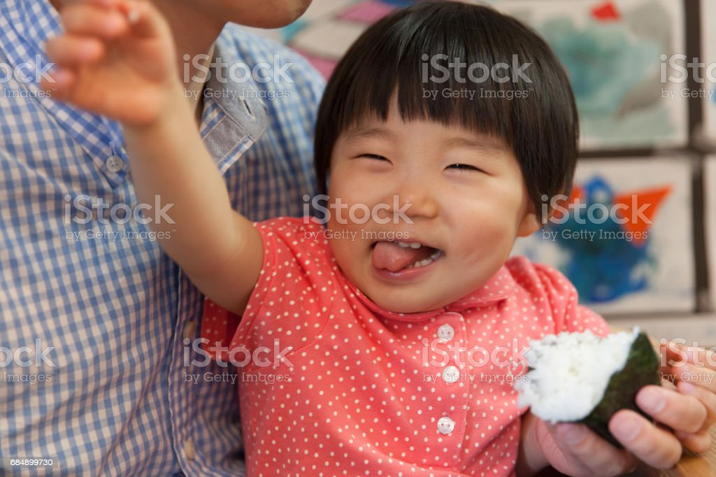 Baby girl eating meal - foto stock