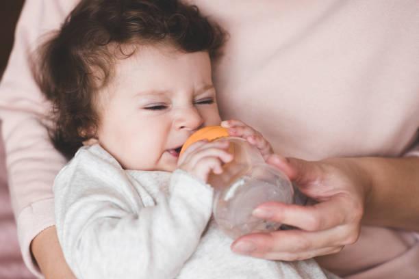 Baby girl eating stock photo