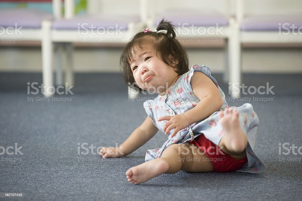 Baby girl falling in a nursery. royalty-free stock photo