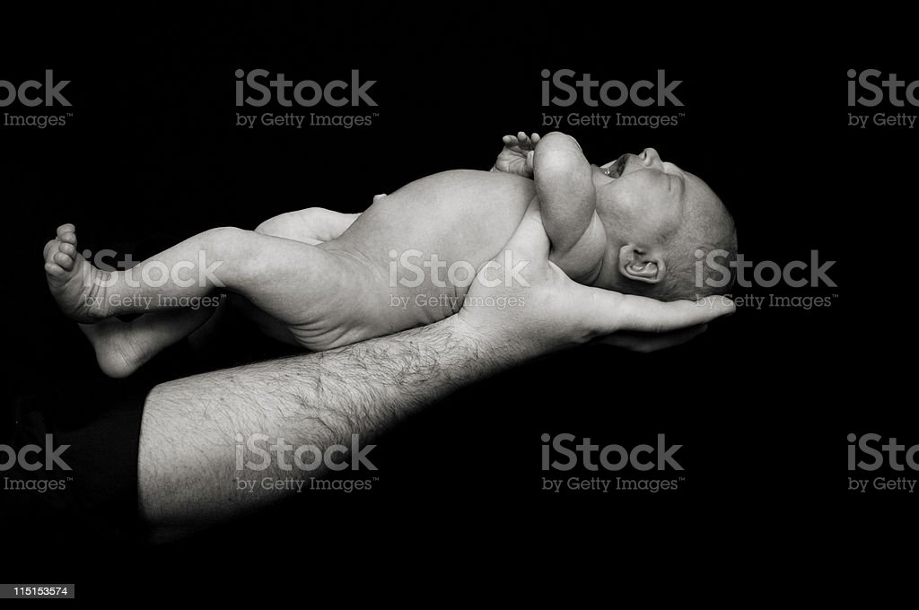 baby girl father hands stock photo
