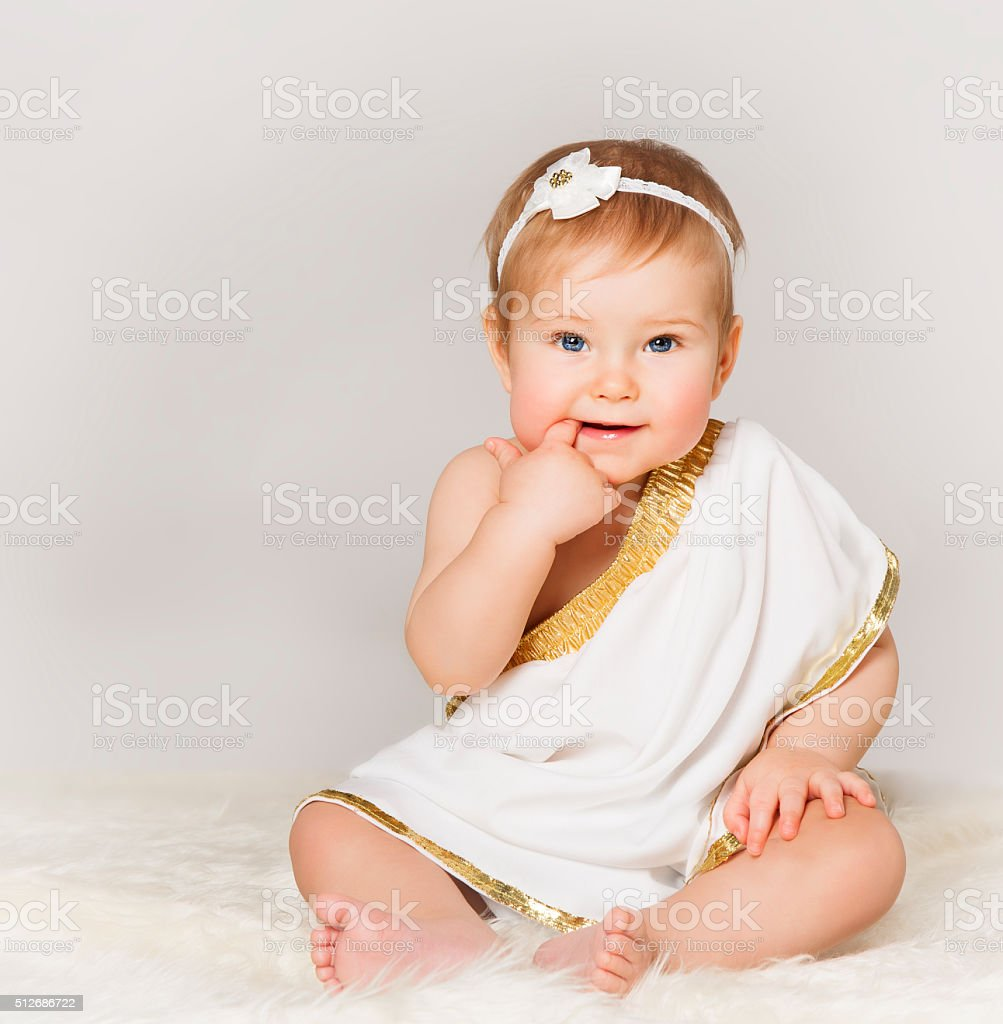 Baby Girl Finger in Mouth, Toddler Kid Sitting in White stock photo