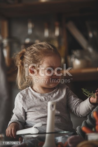 istock Baby girl frowning after she tried radishes 1135709071