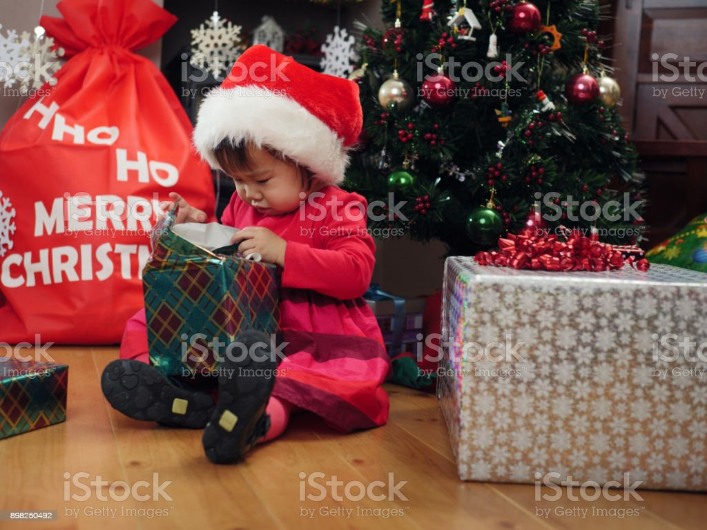 Baby Girl Gets Her Christmas Gift Stock Photo & More Pictures of ...