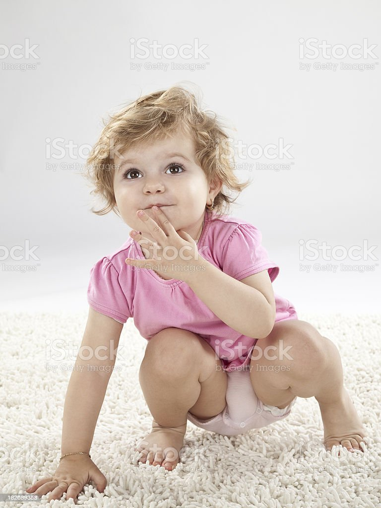 Baby girl, hand on lips royalty-free stock photo
