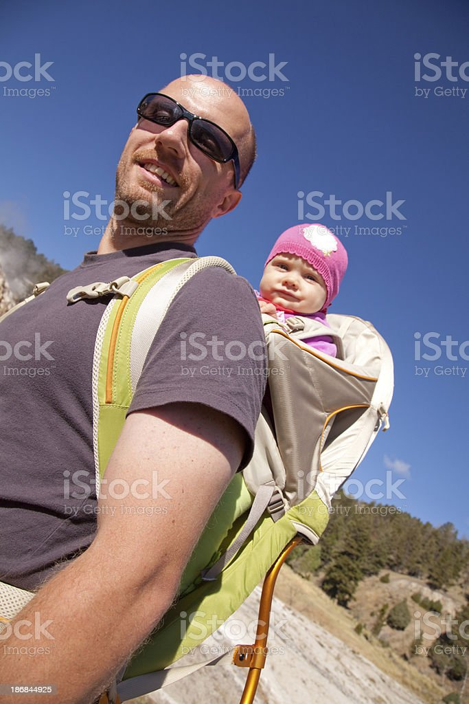 Baby girl hiking with father royalty-free stock photo