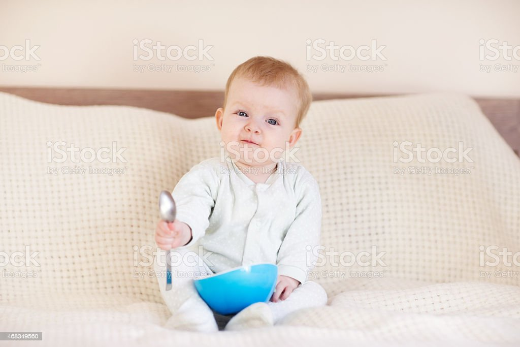 Baby girl holding a spoon royalty-free stock photo
