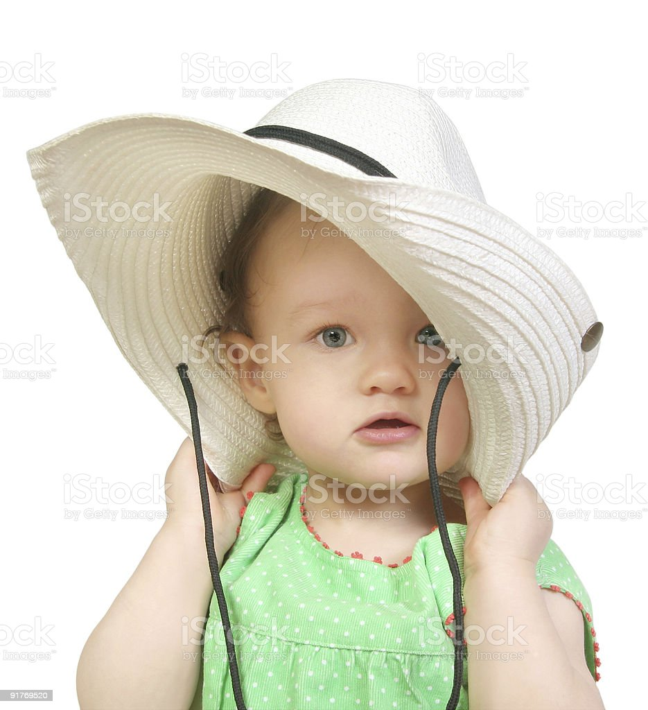 baby girl in a big white hat stock photo