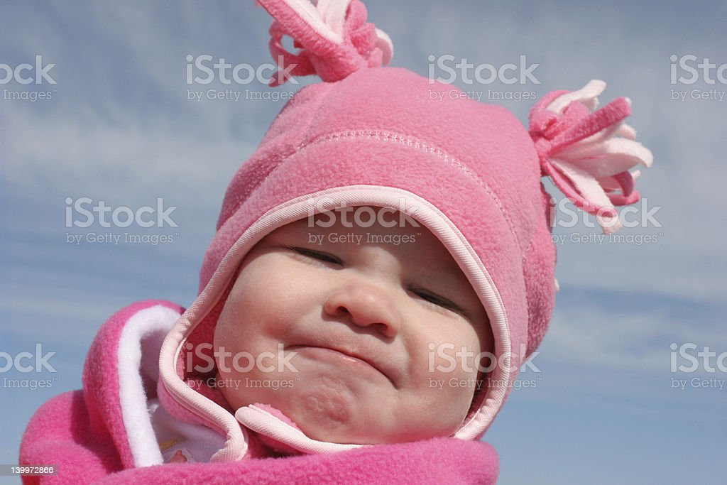 Baby Girl in a Pink Hat stock photo