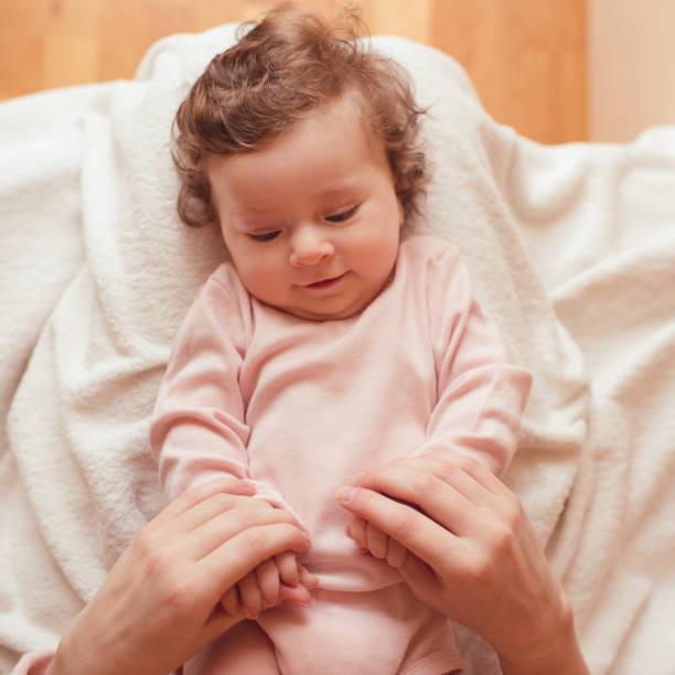 Baby girl in bed stock photo
