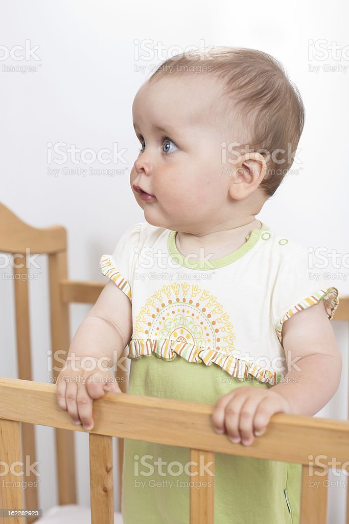 Baby girl in child bed royalty-free stock photo