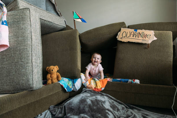 Baby Girl in Couch Fort stock photo