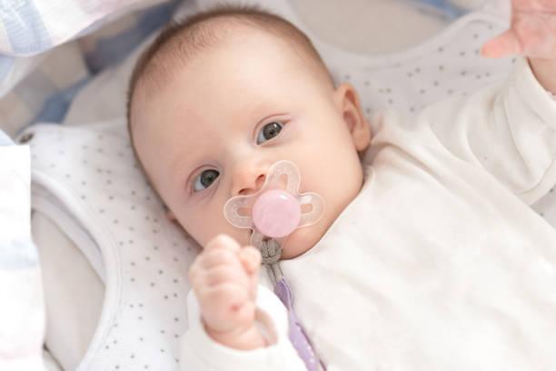 Baby girl in her crib stock photo