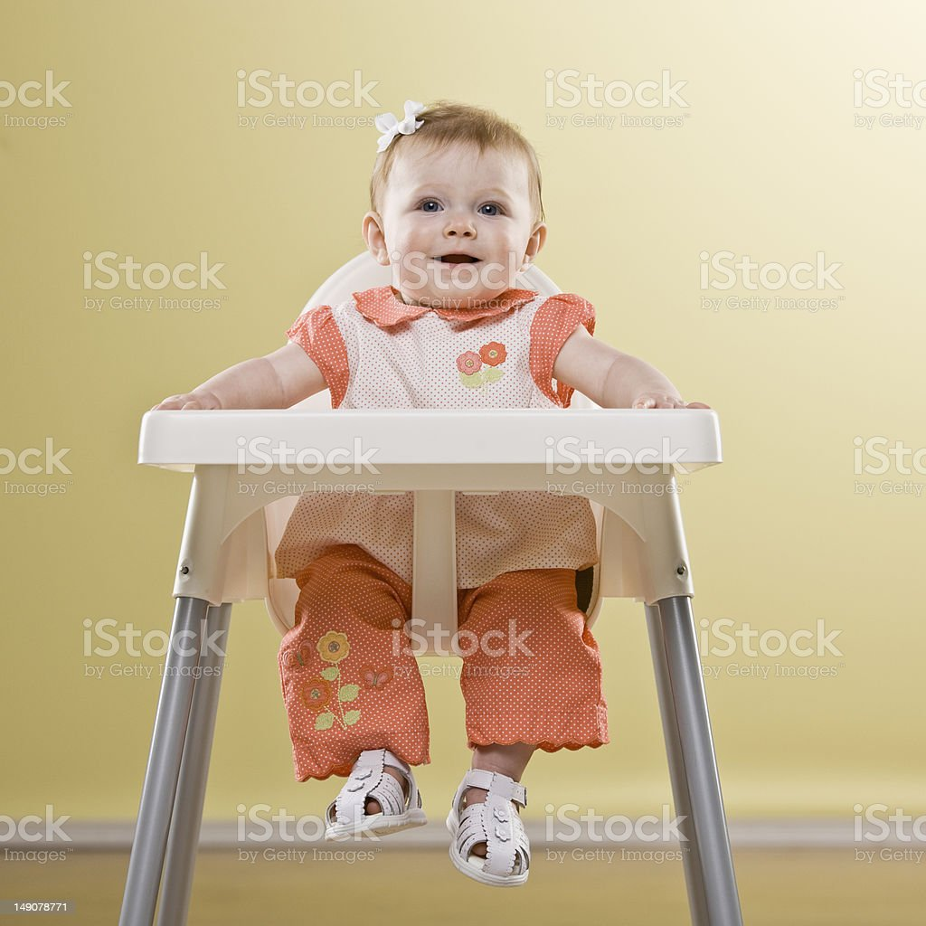 Baby Girl in High Chair stock photo