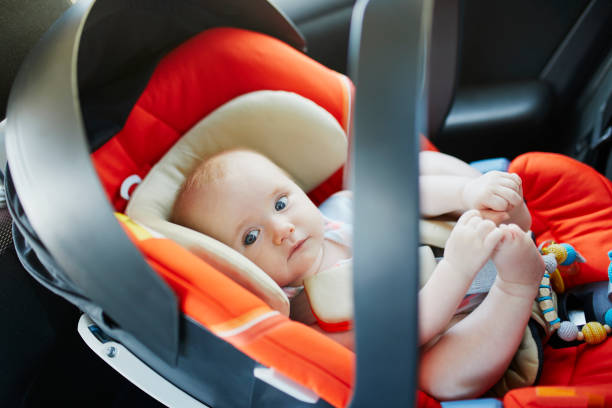 baby girl in modern car seat stock photo