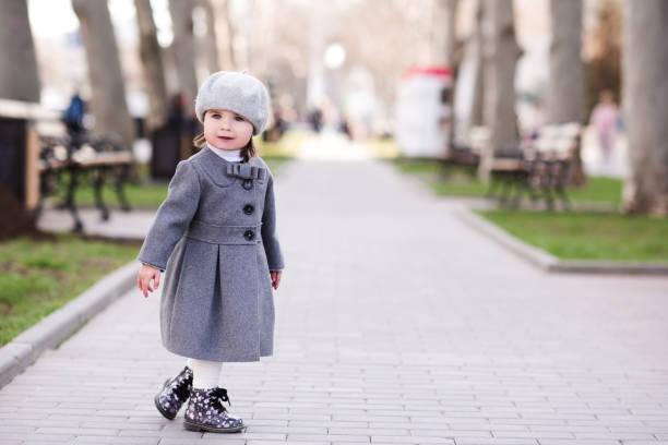 Baby girl in park stock photo