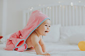 Baby girl in pink bathrobe