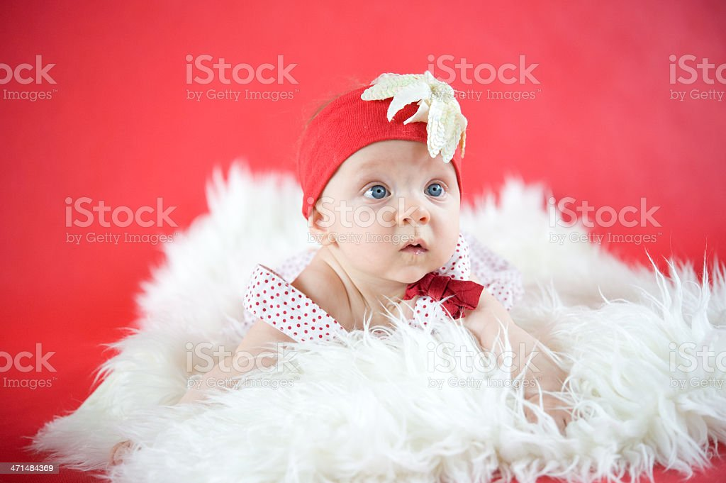 Baby girl in red royalty-free stock photo