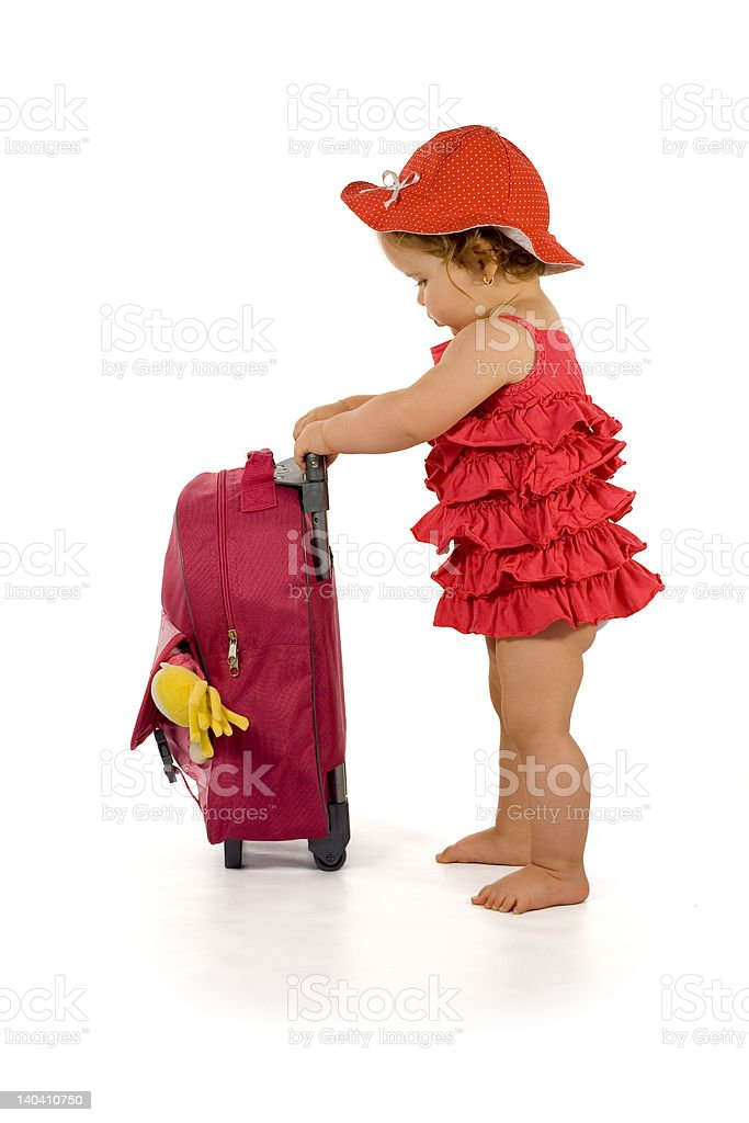 Baby girl in red with luggage - isolated royalty-free stock photo